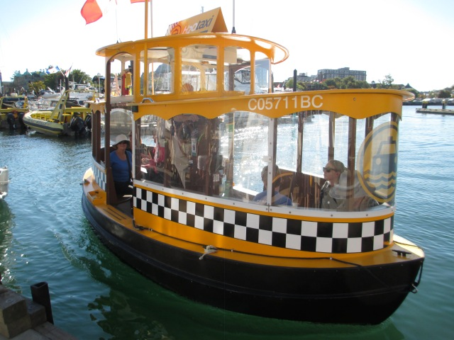 One of many water taxis scurrying about Victoria's harbour