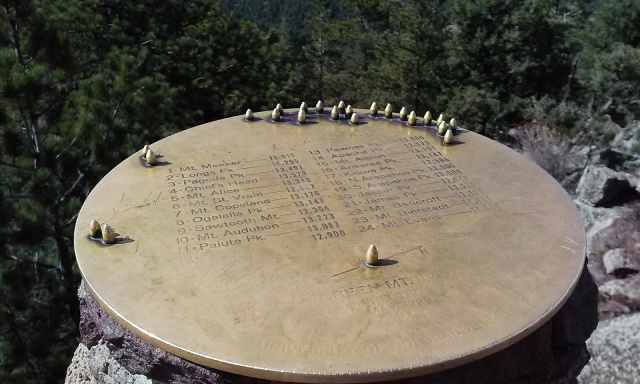 Brass plate geographical guide on top of the cairn at the peak of Green Mountain