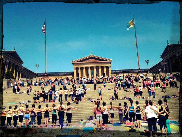 Yoga on the steps of the Philadelphia Museum of Art - Source: yogapeach.com